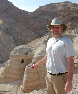 Ryan Habbena in front of Cave 4 at Qumran.